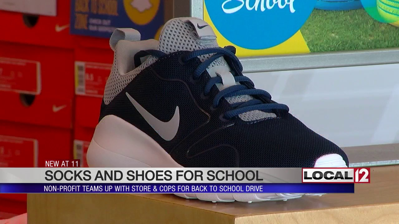 eaa7f87bc Socks and shoes for school  Nonprofit teams up with cops