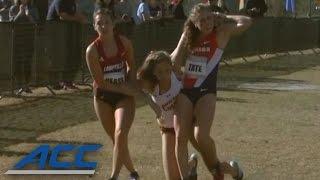 Rivals Help Injured Runner Across Finish Line