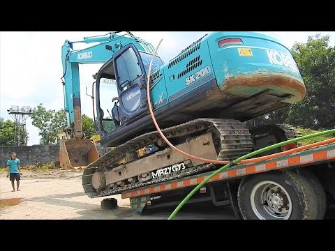 Excavator Mobilization Kobelco SK200 By Fuso Self Loader Truck