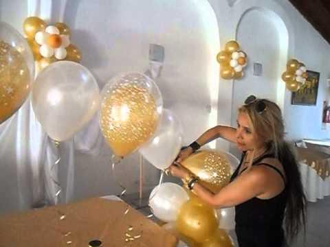 Inflado de un globo dentro de otro con gas helio por for Decoracion con globos precios