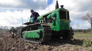 Vintage tractors ploughing