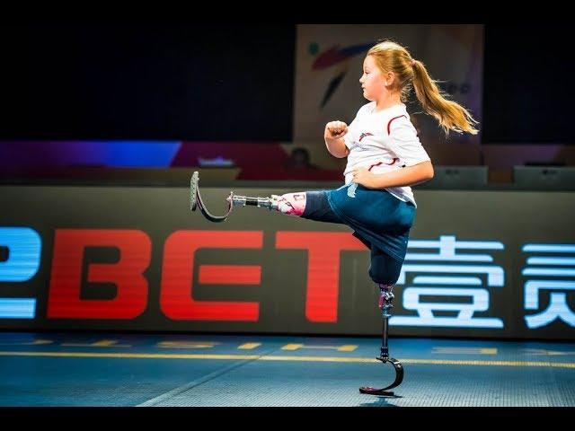 Maisie Catt, a double leg amputee, shows off Taekwondo moves