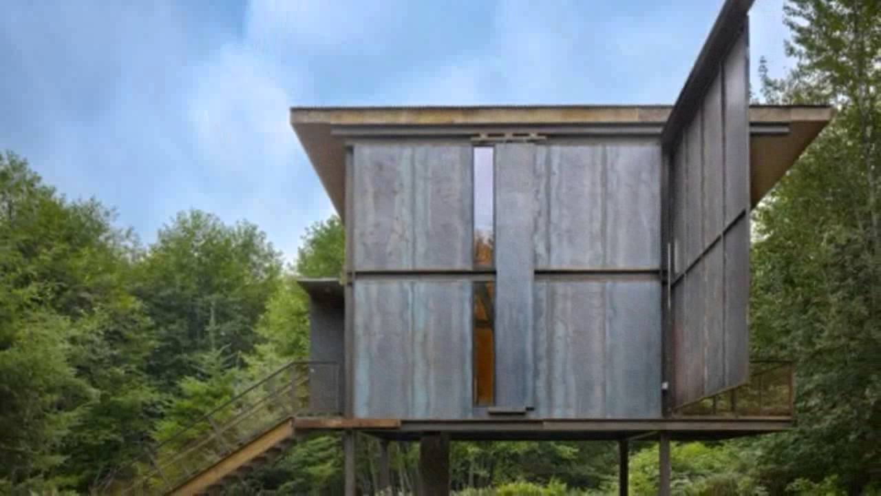 Steel clad 350 sq ft modern cabin on stilts with shutters youtube - The shutter clad house ...