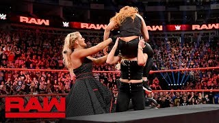 Charlotte Flair and Lacey Evans drive Becky Lynch through a table Raw May 13 2019