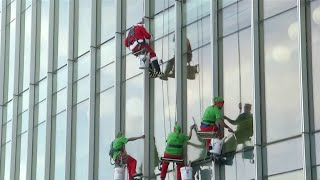 Santa, elves bring holiday cheer, clean windows to Nemours Children's Hospital