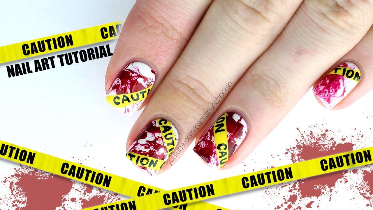 Beautiful Caution Tape With Blood Splatter Halloween Nail Art