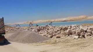 New Suez Canal: the hills of stones on either side of the Suez Canal and the new aim