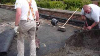 Old felt flat roof being replaced with a new EPDM Rubber roof.