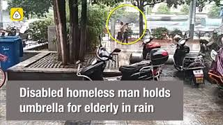 Humbling moment: Disabled homeless man holds umbrella for elderly in rain in south China