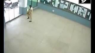 Man walks through glass door