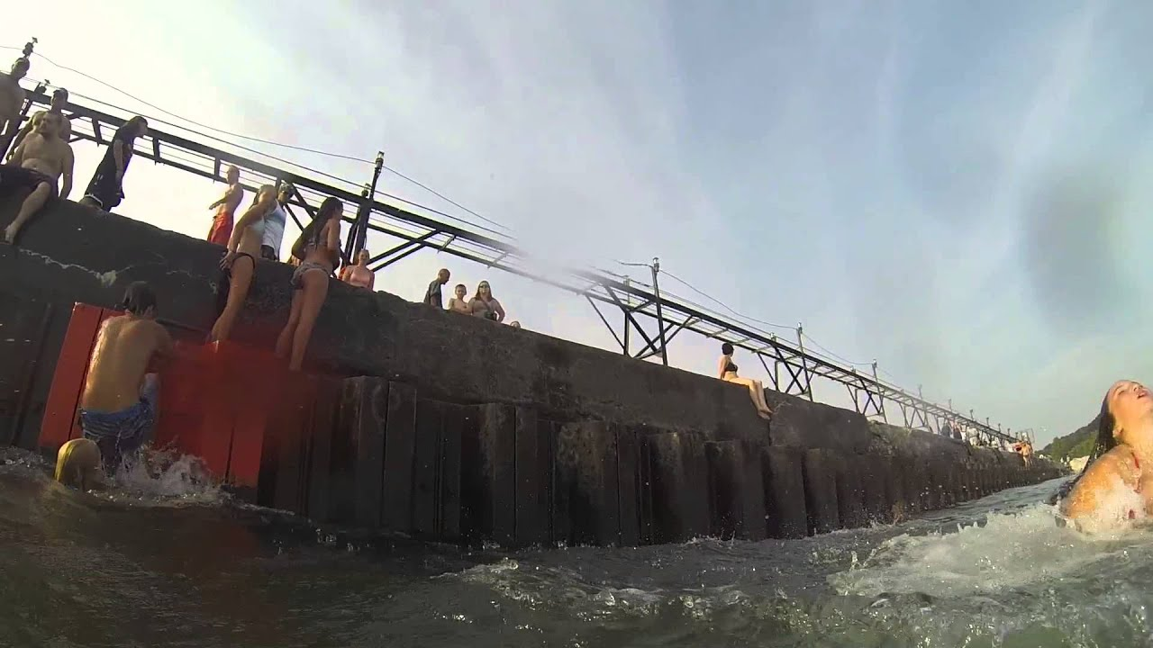 Pier jumping grand haven mi youtube for Grand haven fishing report