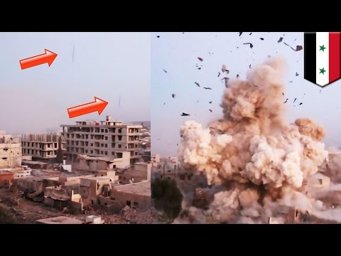 Syrian war: Massive barrel bomb explosion destroys rebel building in Daraya - TomoNews