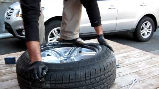mounting a car tire on a rim