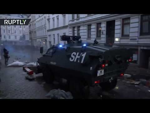 RAW: Police truck sweeps over protesters' barricades at anti-G20 demo