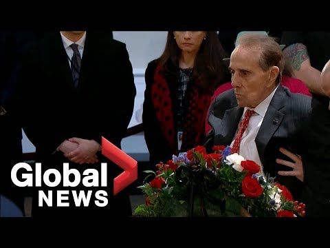 Bob Dole salutes the casket of George H.W. Bush in emotional moment