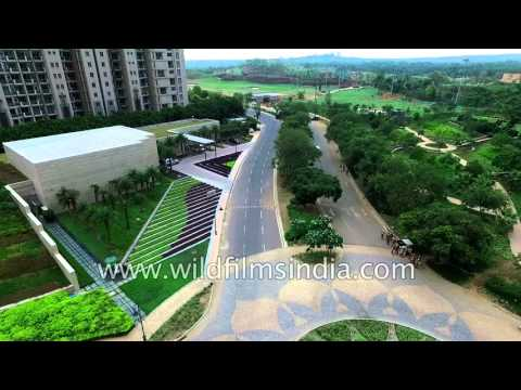 Aerial: Luxury pool and lush greenery of DLF Golf and Country Club, Gurgaon