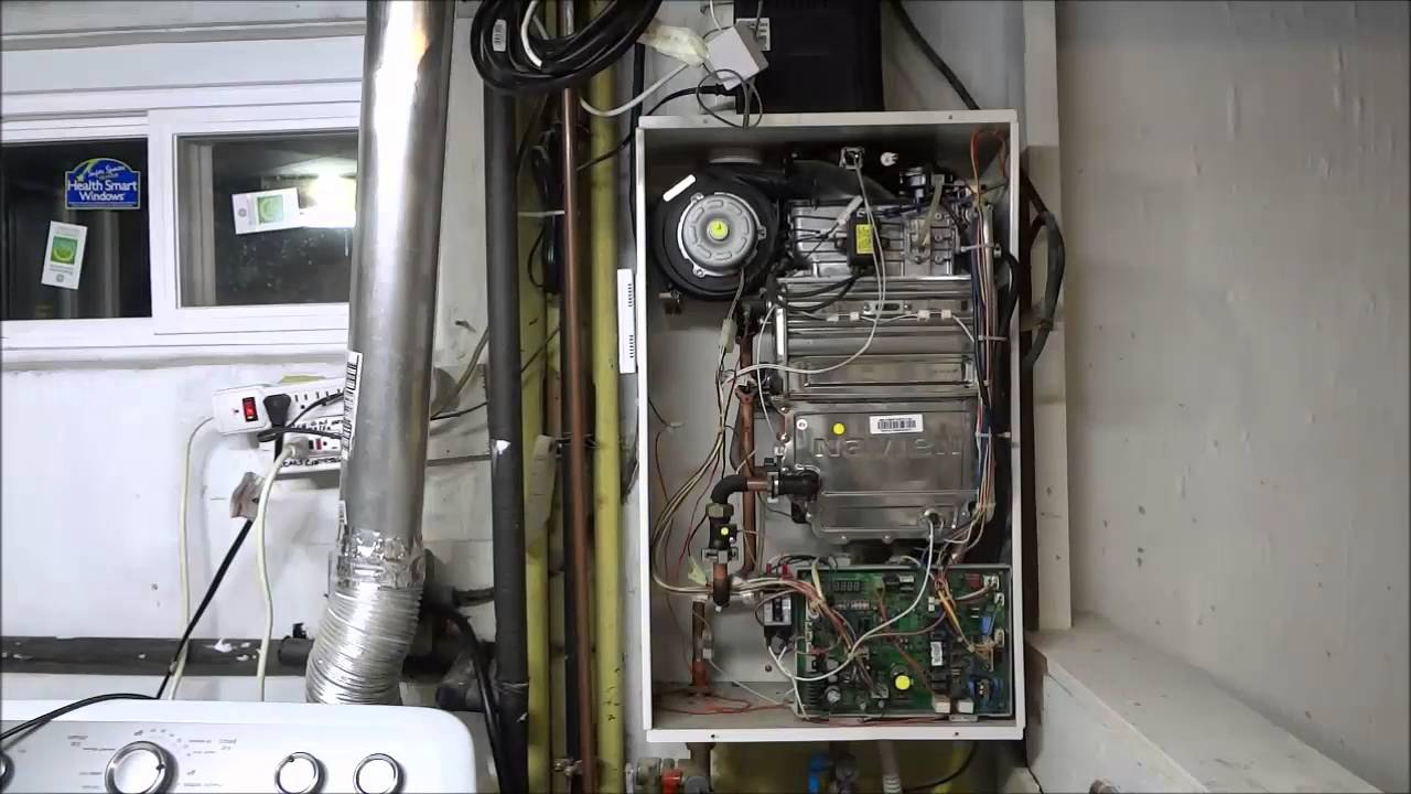 how to clean the air filter in a navien tankless water heater [ 1280 x 720 Pixel ]