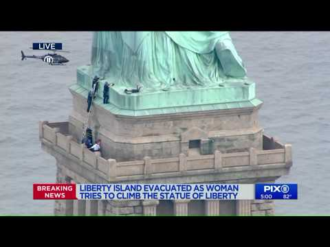 Woman climbing Statue of Liberty on July 4th, police say