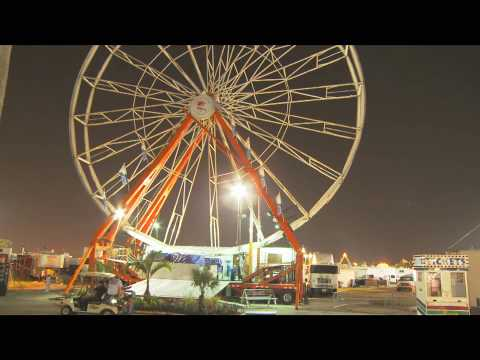 HD Time Lapsed Transforming Ferris Wheel -  Carnival Rides - HD Stock Footage