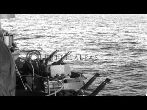 USS warships shell Makin Island. HD Stock Footage