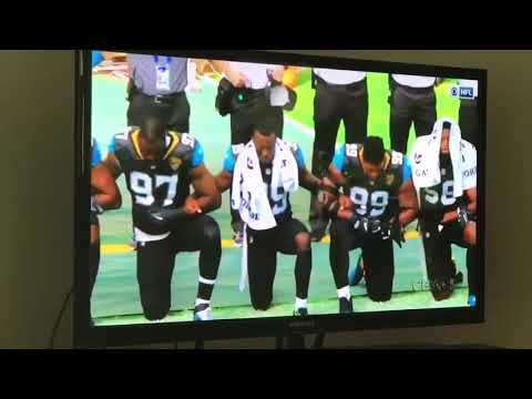 Players From Jaguars And Ravens Kneel During National Anthem At NFL Game In London