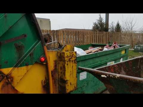 Wm mcneilus rear loader emptying dumpsters