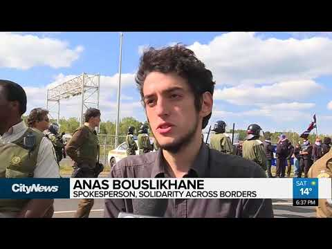 Nationalist protesters face-off with counter-protesters at Quebec border