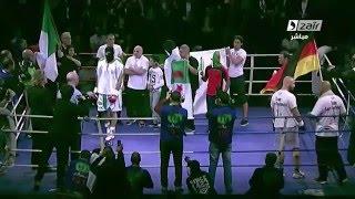 منازلة الملاكمة بين الجزائري بن مخلوف والألماني بوشولز ، تعليق فوزي بن جامع