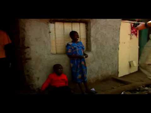 Kenya - Kids standing by wall.
