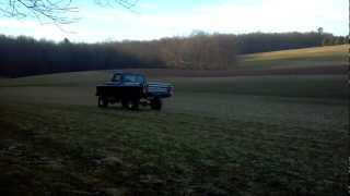 79 F100 shortbed 4x4 playing in the field