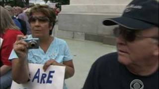 Protesters Compare Obama to Hitler