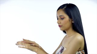 Beautiful Indian female applying moisturizer on her hands - Skincare concept