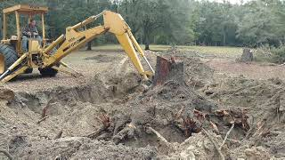 Digging up an old pecan stump with a 1987 Ford 655A backhoe