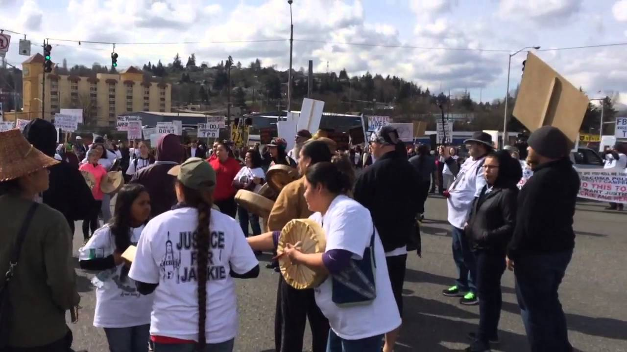 Protesters march in Tacoma, in response to officer driving through ...