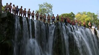 Daredevil Divers Compete at Bosnia Waterfall