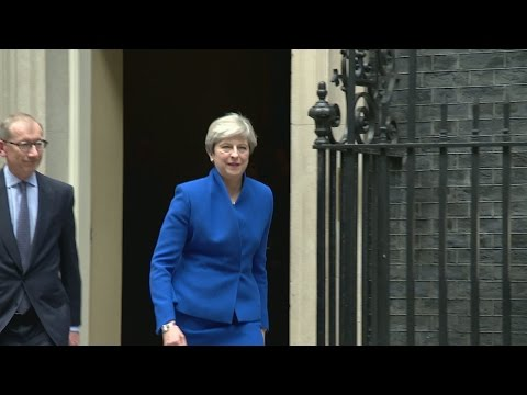 Theresa May exits 10 Downing Street and heads for Buckingham Palace