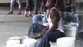 AMAZING Street Drummer on buckets