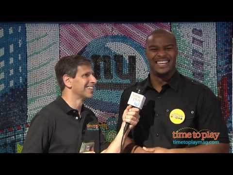 Osi Umenyiora of the NY Giants talks to Jim Silver at the M&M Personalize Your M&M