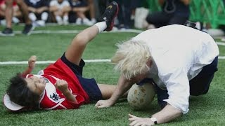Boris Johnson knocks a child to the ground in touch rugby