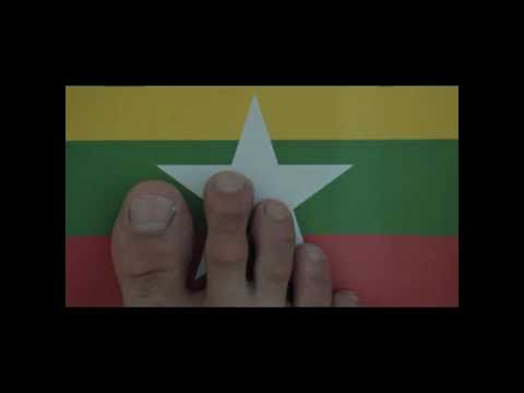 Foot on the flag of Myanmar with Kaba Ma Kyei