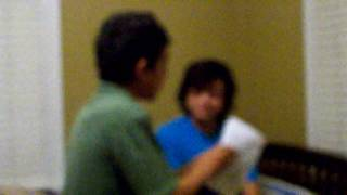 dad getting report card from geeky son