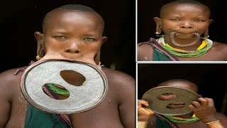 Largest Lip Plate: Woman with the World'...