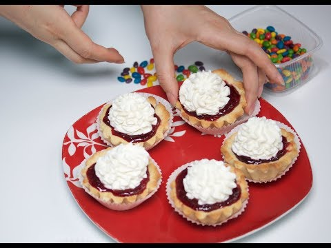 """Pastry """"Basket"""" with a filling of jam and cream. Preparation of organic bakery products in homemade."""