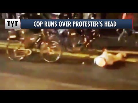 Seattle Cop Runs Over Protester's Head