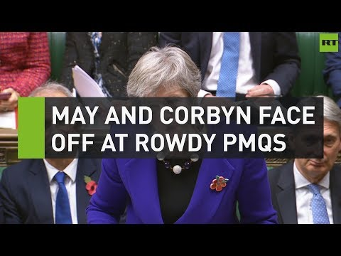 May and Corbyn face off at rowdy PMQs