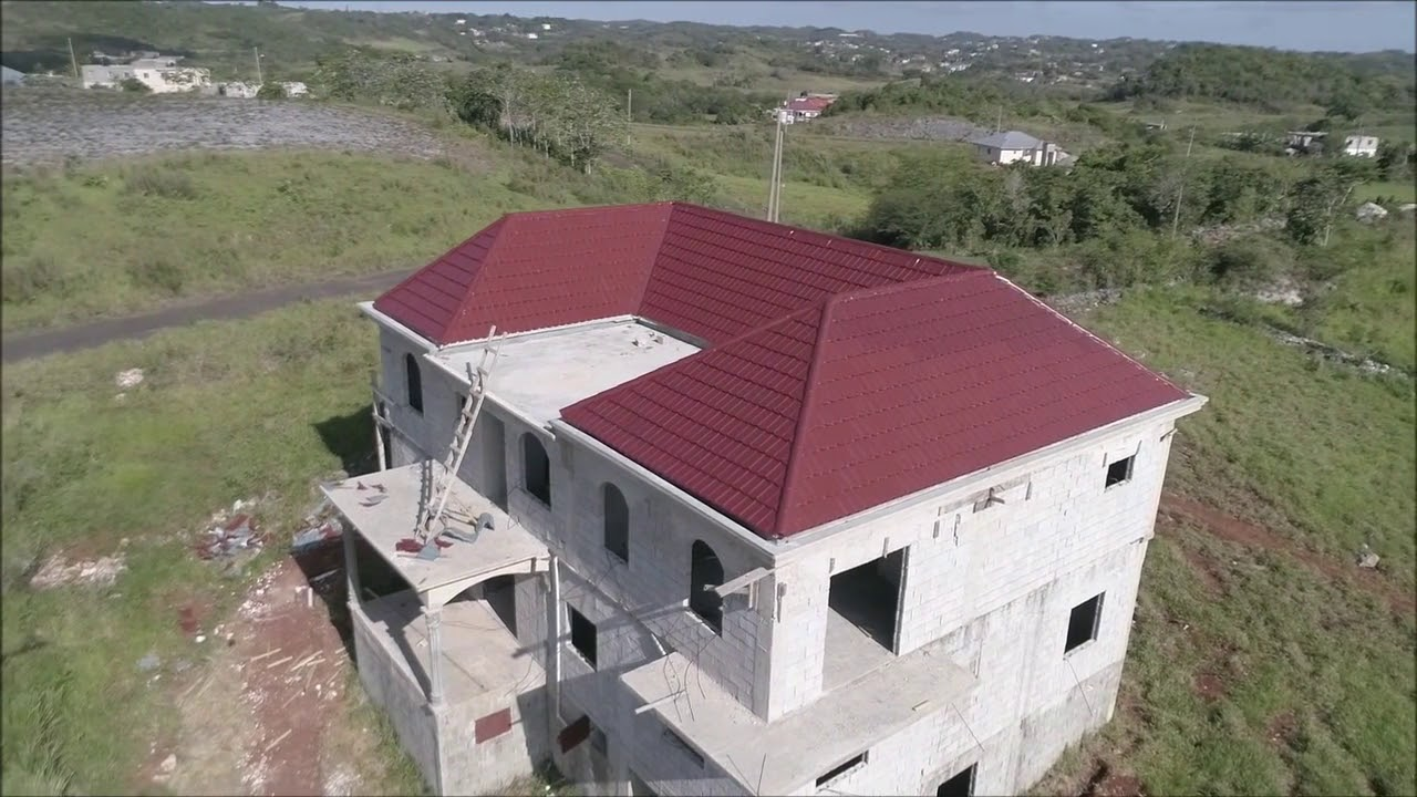My Jamaican dream house Part 10 - Roof and Plumbing ( Building a house in Manchester Jamaica )