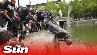 BLM protesters pull down statue of Edward Colston before throwing it into river in Bristol