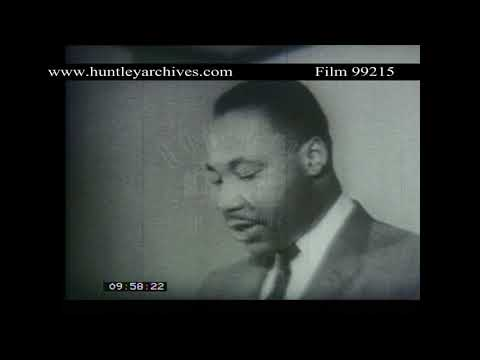 Martin Luther King Calls off Bus Boycott following legal ruling in his favour.  Archive film 99215