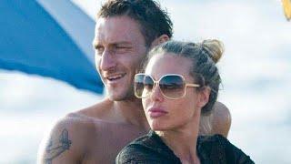 Ilary Blasi bacia Francesco Totti, ma il calciatore non sembra affatto contento: lite nella coppia?