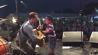 JW-Jones w/2-year-old on stage - Canada